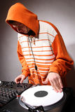 Hip hop DJ scratching the music record Royalty Free Stock Photos