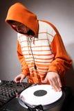 Hip hop DJ scratching the music record Royalty Free Stock Photos