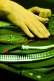 Hip-hop DJ scratching the record Royalty Free Stock Image