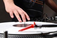 Hip-hop dj scratching record with music Stock Photos