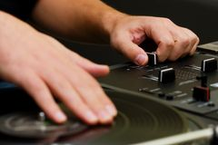 Hip-hop DJ scratching the vinyl Royalty Free Stock Photo