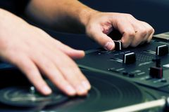 Hip-hop DJ scratching the vinyl Royalty Free Stock Image