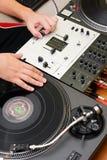 Hip-hop DJ scratching the vinyl record Stock Images