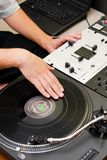 Hip-hop DJ scratching the vinyl record Royalty Free Stock Photo