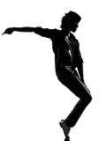 Hip hop funk dancer dancing man. Full length silhouette of a young man dancer dancing funky hip hop r&b on  isolated  studio white background Stock Photo