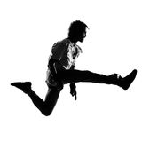 Hip hop funk dancer dancing man. Full length silhouette of a young man dancer dancing funky hip hop r&b on isolated studio white background stock photography