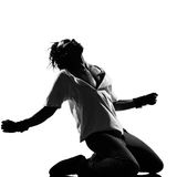 Hip hop funk dancer dancing man kneeling screaming. Full length silhouette of a young man dancer dancing kneeling screaming funky hip hop r&b on isolated studio royalty free stock photography