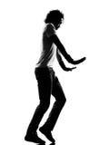Hip hop funk dancer dancing moonwalk man. Full length silhouette of a young man dancer moonwalk dancing funky hip hop r&b on isolated studio white background stock images