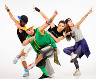 Hip hop gang. Posing. One male. Three females stock images