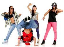 Hip hop gang. Posing. One male. Three females royalty free stock photo