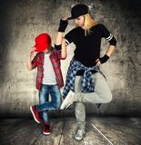 Mother and son dance hip-hop.Urban lifestyle. Hip-hop generation. Hip-hop generation.Mother and son dance hip-hop.Urban lifestyle stock images