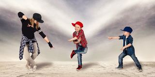 Mother and two son dance hip-hop.Urban lifestyle. Hip-hop generation. Hip-hop generation.Mother and two son dance hip-hop.Urban lifestyle royalty free stock image