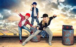 Mother and two son dance hip-hop.Urban lifestyle. Hip-hop generation. Hip-hop generation.Mother and two son dance hip-hop.Urban lifestyle stock image
