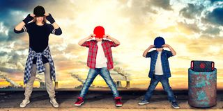 Mother and two son dance hip-hop.Urban lifestyle. Hip-hop generation. Hip-hop generation.Mother and two son dance hip-hop.Urban lifestyle stock images