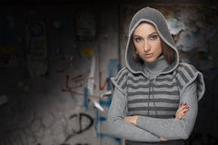 Hip hop girl. Young woman with hood in hip hop style royalty free stock images
