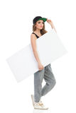 Hip hop girl carrying blank placard. Stock Photography