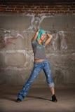 Hip hop girl dancing over grey brick wal Stock Photos