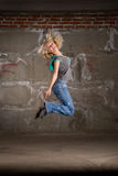 Hip hop girl dancing over grey brick wal Royalty Free Stock Photography