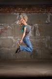 Hip hop girl dancing over grey brick wal Royalty Free Stock Photography