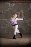 Hip hop girl dancing over grey brick wal Stock Photos