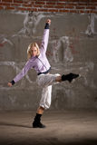 Hip hop girl dancing over grey brick wal Stock Images