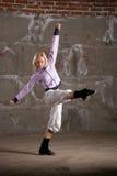 Hip hop girl dancing over grey brick wal Stock Images