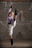 Hip hop girl dancing over grey brick wal Stock Image
