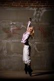 Hip hop girl dancing over grey brick wal Royalty Free Stock Image