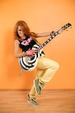 Hip-hop girl with guitar. Cheerful red haired hip-hop girl with guitar Stock Photos