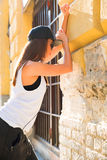 Hip hop girl with headphones in a urban environment Stock Photo