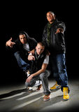 Hip Hop Group. Hip hop dancers posing over a dark background stock images