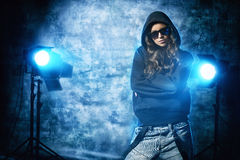 Hip-hop grunge. Modern hip-hop dancer over grunge background Royalty Free Stock Image