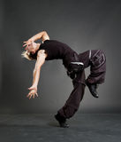 Hip-hop guy showing cool motion. Against dark background royalty free stock images