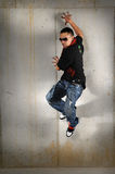 Hip Hop Jumping Against the Wall Royalty Free Stock Photo