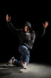 Hip Hop Man Dancing. African American hip hop man dancing over dark background stock photography