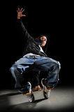 Hip Hop Man Dancing. Over a dark background Stock Image