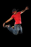 Hip Hop Man Jumping. African American hip hop dancer jumping isolated over black background Royalty Free Stock Photography