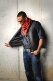 Hip Hop Man over Grunge Wall Stock Photo