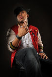 Hip Hop Man Posing. African American hip hop man posing over dark background Royalty Free Stock Images