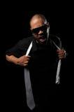 Hip Hop Man Pulling Tie Royalty Free Stock Photos