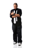 Hip Hop Man Standing. African American hip hop man gesturing isolated over white Royalty Free Stock Photo