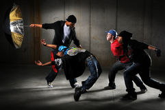Hip Hop Men Performing. And act over an urban background Stock Image