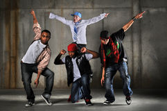 Hip Hop Men Performing. Hip hop men dancing over a grunge background Royalty Free Stock Photo