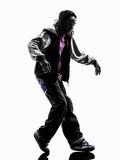 Hip hop moonwalking break dancer breakdancing young man silhouet. One hip hop acrobatic break dancer breakdancing young man moonwalking silhouette white Stock Photo