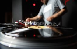 Hip hop party dj plays music with turntables in club royalty free stock photo