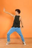 Hip-hop performer at the studio. Young hip-hop performer posing on vivid background Stock Photography