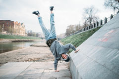 Hip hop performer, upside down motion on street Royalty Free Stock Image