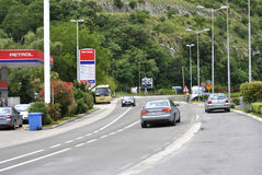 Hip Hop Petrol gas station and road. Igalo, Montenegro – June 15, 2016: Detail of Hip Hop Petrol gas station and part of road with vehicles. Hip Hop Petrol gas Stock Photos