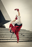 Hip Hop street dancer one hand stand Royalty Free Stock Image