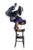 Hip Hop Style Dancer performing usind a chair Stock Images